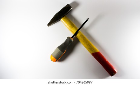 Red Hammer and screw - symbol of repair service workroom - isolated