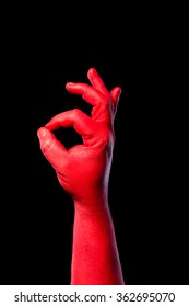 Red hand showing ok sign