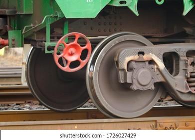 Red handbrake wheel of a cargo wagon.