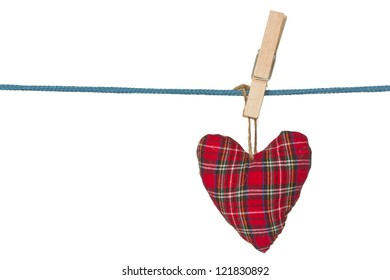 Red handmade heart hang on a clothes line