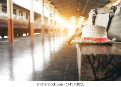 A red hat and bag on a chair at train station.travel concept.