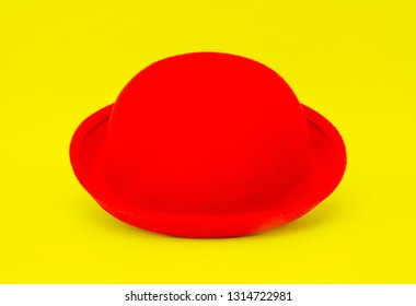 Red hat isolated on the yellow background