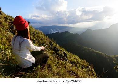 Red hat woman on mountain