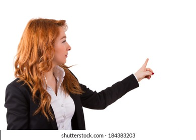 Red head business woman pointing her finger in her copy space, isolated on white background.