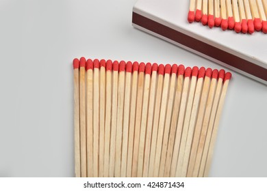 Red head matches in a white opened box on white background