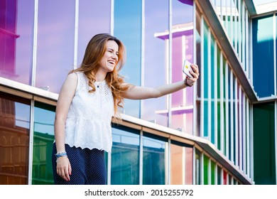 Red head young woman taking a selfie jovially
