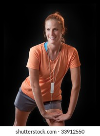 Red headed woman stretches and prepares to jog