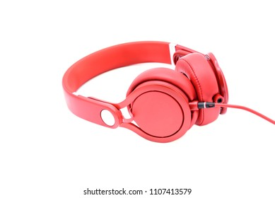 Red headphones isolated on white background.