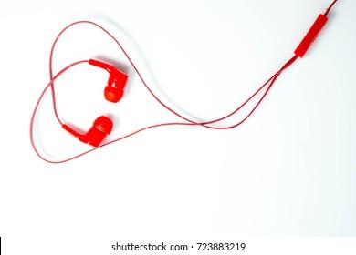 Red headphones on white