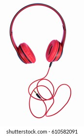Red headphones on white background