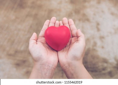 Red heart ball : Stress reliever foam ball the red heart shape on woman hand. Gift valentine's Day