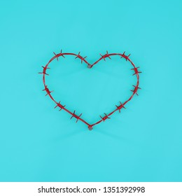 Red heart of barbed wire on a blue solid background. The concept of a broken heart or heart disease. Minimal concept. Flat lay