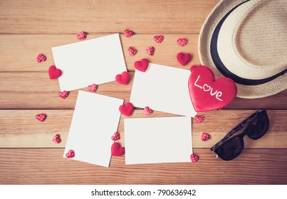 Red heart with Blank white card on wood for valentine day love concept.
