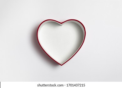 Red Heart Box for Valentine's day or special day in love concept. Open empty red gift box with a heart shape isolated on white background.High resolution photo.Mock-up.