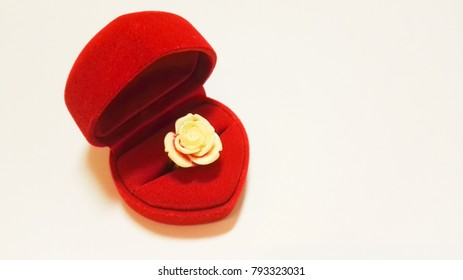 Red heart box with a white rose ring