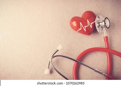 red heart cardiogram with stethoscope, heart health,  health insurance concept