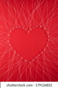 Red heart connected to exterior by threads