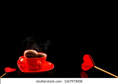 Red heart cup of coffe on the black background. Space for text