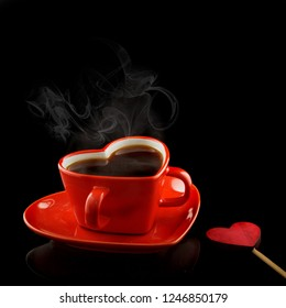 Red heart cup with wooden homemade hearts and coffee. Black background. Valentine day concept
