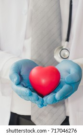 Red heart in doctor physician hands,The heart transplant medicine, Health care concept.