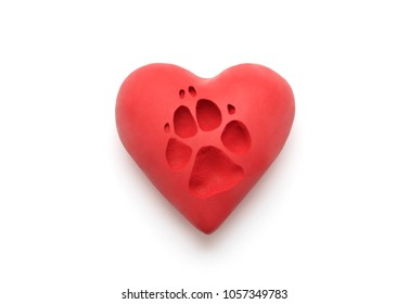 Red heart with dog paw print over white background with clipping path