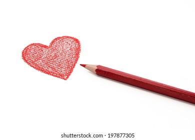 Red heart drawn with a colored pencil isolated on white