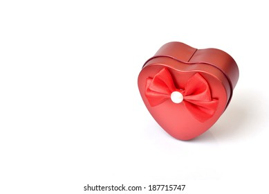 Red heart gift box on white background.