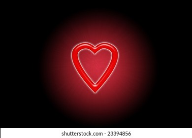 red heart glowing in the dark in blurred circle