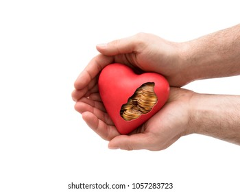 Red heart with golden coins in hands over white background with clipping path