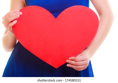Red heart greeting card. Love symbol. Female hand hold Valentine day symbol sign with copy space. Isolated studio shot