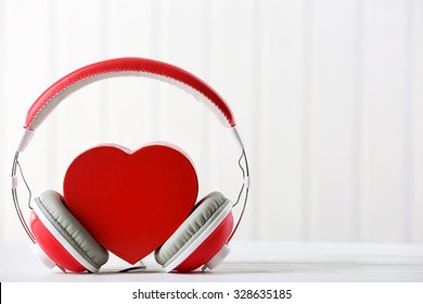 red heart with headphones on white background