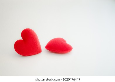 Red heart isolated placed on a white background