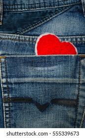 Red heart in jean pocket