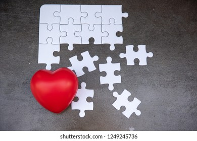 Red Heart and Jigsaw Puzzle Concept, Creative Idea of Weakness Failure in Love. Solution Proplem Solving of Love Broken Heart, Missing Last Piece of Jigsaws.