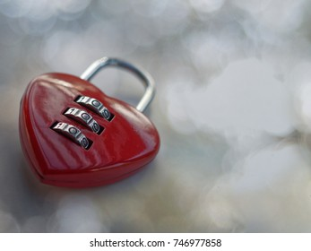Red heart lock with beautiful background and blinding spots / copy space