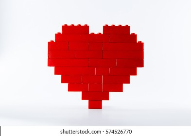 red heart made of Lego blocks with white background