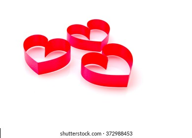 Red heart made from ribbon on whit for valentine background