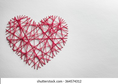 Red heart made from wool,Valentines day concept.