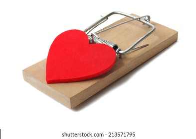 Red heart and mousetrap isolated on white background