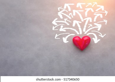 red heart object with white arrow direction in many way love solution concept with free copyspace for your creativity ideas text