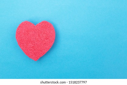 Red heart on a blue background. Concept of human heart disease and heart bypass surgery. Myocardial infarction and angina pectoris, copy space