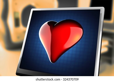 red heart on blue background at monitor