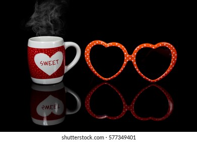 Red heart on coffee cup and glasses of love.