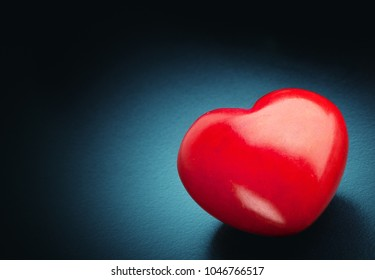 Red heart on the dark background