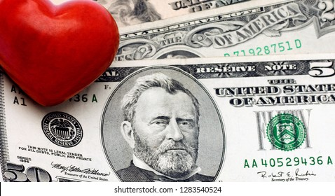 Red Heart on dollar concepts background, Decoration for Valentine's day.