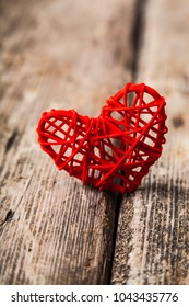 Red heart on an old wooden background. Greeting card for Valentine's Day, Wedding or Birthday