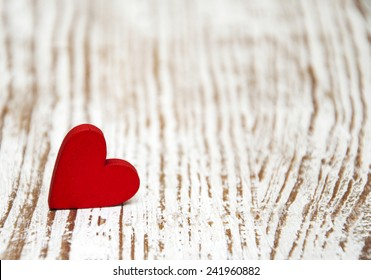 Red heart on a old wooden  background