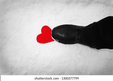 Red heart on white snow on which the man's boot came-a symbol of trampled love.