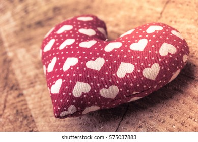 red heart on wood