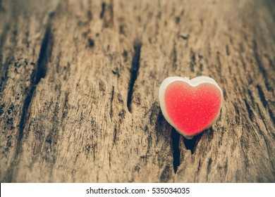 Red heart on wood background Valentines day and vintage tone